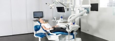 Female patient laying on a dentist chair from KaVo